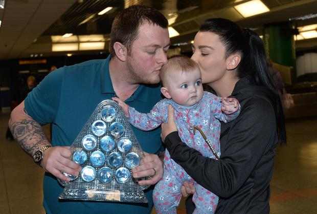 PACEMAKER BELFAST 22/01/2018 2018 Masters snooker champion Mark Allen returns home to Northern Ireland with his wife Kyla and Baby Harleigh and gets a heroes welcome from family, friends and fans at Belfast International Airport this evening. Photo Colm Lenaghan/Pacemaker Press