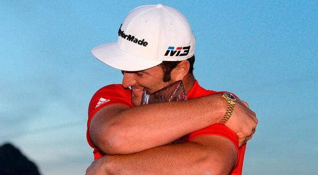 Tight grip: Jon Rahm with the CareerBuilder Challenge title
