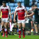 Down and out: Ulster's Stuart McCloskey and Darren Cave look dejected after a Wasps try