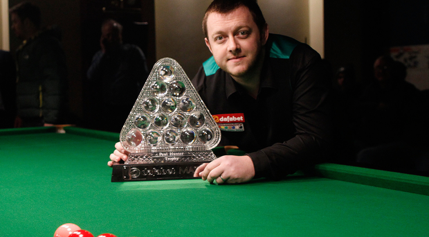 Prize guy: Mark Allen shows off the Masters trophy at the Trinity Snooker Club on the Shankill Road last night before an exhibition match against Joe Swail