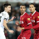 Swansea's Federico Fernandez (left) suffered a nose injury when celebrating Alfie Mawson's winner against Liverpool