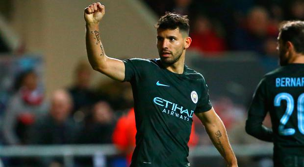 Sergio Aguero celebrates making it 2-0
