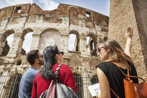 A tour group take in the wonderful views of the Colosseum
