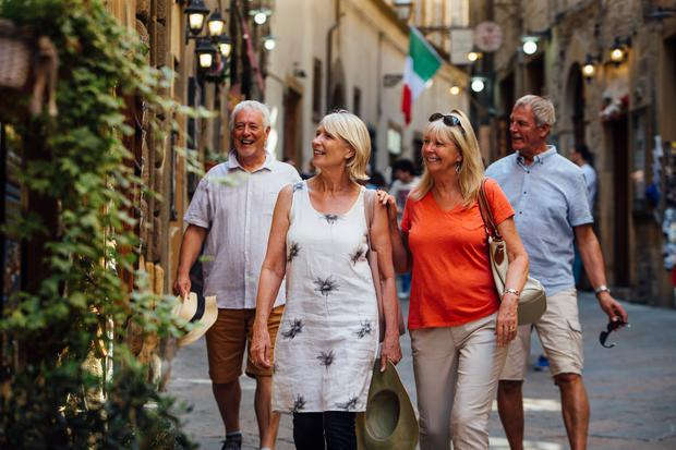 A group of friends enjoying old town Italy as the evening draws in