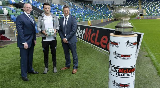 Pictured at the Bet McLean League Cup launch are Paul McLean, Andy Johnston (NIFL) and Conor McCloskey from Ballymena United.