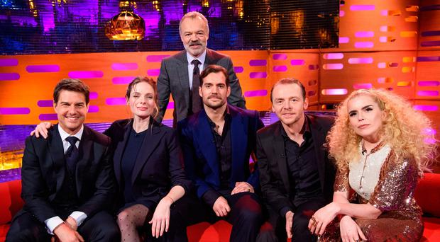 Host Graham Norton stands behind, left to right, Tom Cruise, Rebecca Ferguson, Henry Cavill, Simon Pegg and Paloma Faith (PA Images on behalf of So TV/PA Wire)