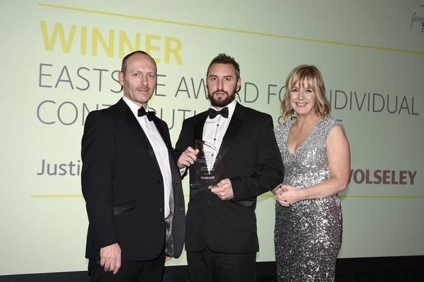 Justin McMinn of Street Soccer NI receives Eastside Award for Individual Contribution to Sport from Johnny Berry of sponsor Wolseley and awards host Tara Mills. www.eastsideawards.org