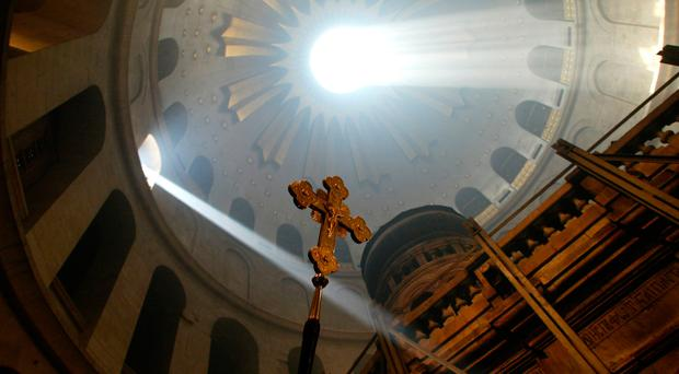 Seeing the light: a ray of sunlight hits what is traditionally believed to be the tomb of Jesus Christ at the Church of the Holy Sepulchre in Jerusalem