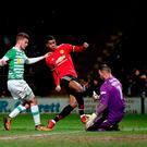 Cool head: Marcus Rashford slots home the opener