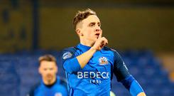 Quiet please: Joel Cooper celebrates scoring and then signals to the home fans who were giving him stick