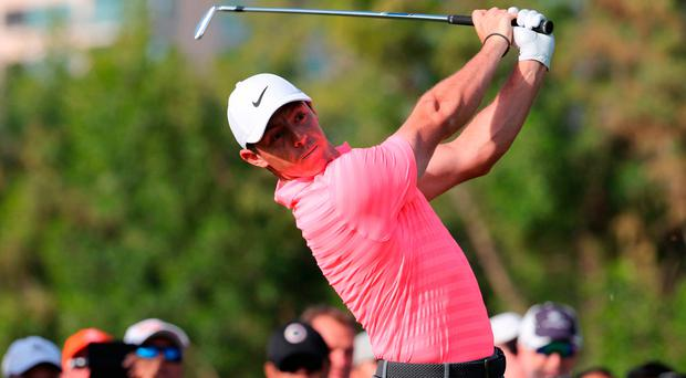 Eyeing it up: Rory McIlroy is driving on