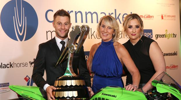 Big night: Jonathan Rea celebrates with his mother Clare and sister Chloe