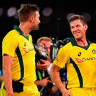 Victors: Andrew Tye and Tim Paine of Australia leave the field after game four of the one-day international series