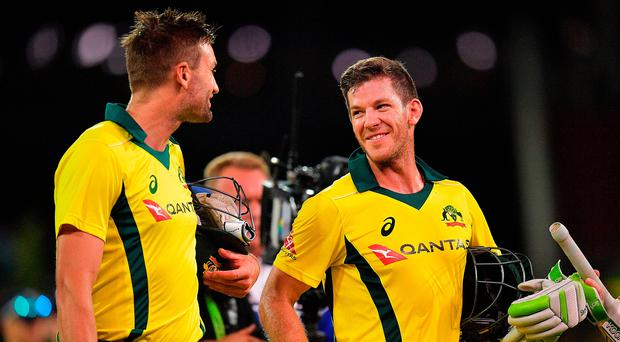 Victors Andrew Tye and Tim Paine of Australia leave the field after game four of the one-day international series