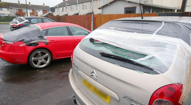 The scene at Carnrawsy Walk in Carrickfergus where a 17-year-old male was arrested on Saturday night after a number of vehicles were damaged on Saturday night. Picture by Jonathan Porter/PressEye