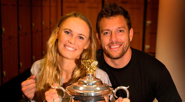 Winner: Caroline Wozniacki celebrates her victory with fiance David Lee