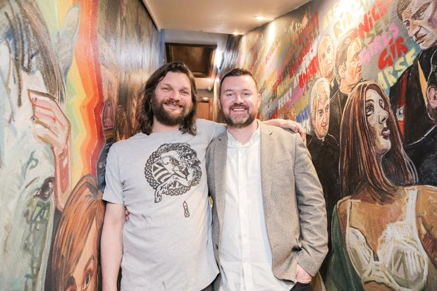 Artist Chris Rutterford and, right, Simon Keane director at Malones Irish Bars.