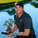 Winning feeling: Jason Day shows off the Farmers Insurance Open title, his first victory since The Players in 2016