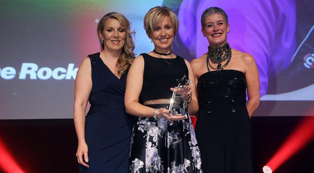Big impact: Joanne Rock of Lagan Dragons is presented with her Game Changer award at last night's Belfast Telegraph Sports Awards. She received her award from Hannah Shields and Clare McAllister, Sales and Marketing Manager Electric Ireland NI, sponsors of the category