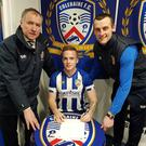 Aaron Burns is welcomed to Coleraine by chairman Colin McKendry (left) and manager Oran Kearney (right).