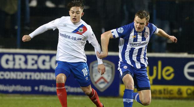 Coleraine's David Ogilby in action with Linfield's Jordan Stewart Pic: INPHO/Matt Mackey