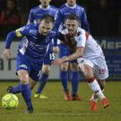 Dungannon's Ryan Harpur in action with Crusaders Mathew Snoddy Photo: Inpho/Stephen Hamilton