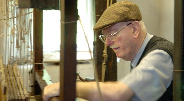 Master craftsman John Bosco McAtasney at work at the loom