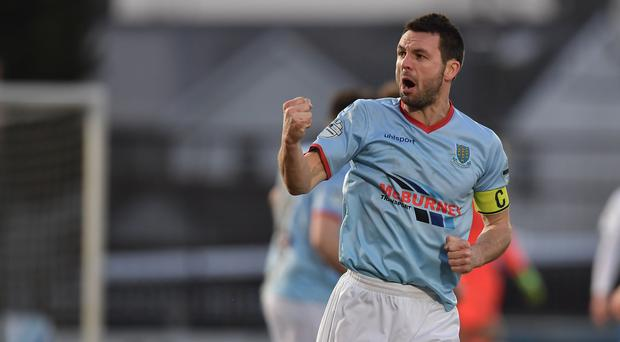 Captain marvel: Jim Ervin celebrates a goal for his Ballymena United side against Linfield and all hell breaks loose
