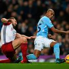 City slicker: Fernandinho slots the ball past West Brom defender Gareth McAuley and into the net