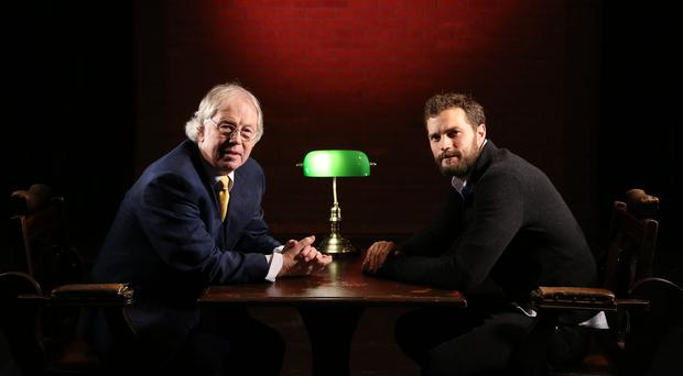 Northern Ireland actor Jamie Dornan speaks to journalist Eamonn Mallie ©Press Eye/Darren Kidd