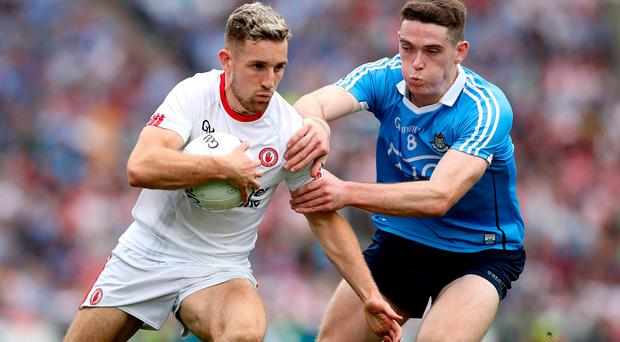 Top teams: Tyrone's Niall Sludden (left) and Dublin's Brian Fenton lock horns last year