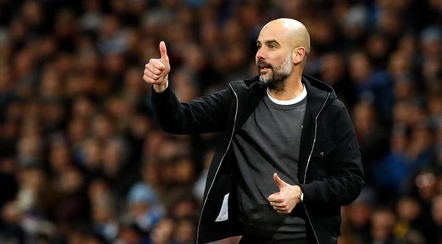 Manchester City manager Pep Guardiola insists the title race is not over