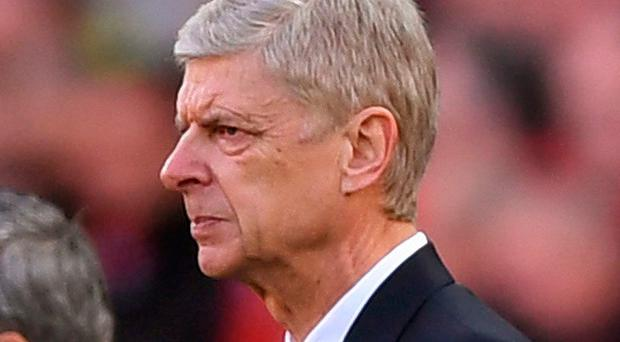 Hitting out: Arsene Wenger