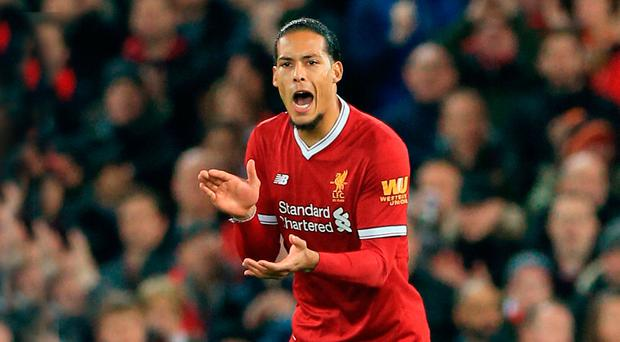Under fire: Virgil van Dijk has been accused of carrying too much weight