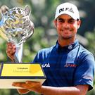TOPSHOT - Shubhankar Sharma of India poses with the trophy after winning the 2018 Maybank Malaysia Golf Championship at the Saujana Golf and Country Club outside Kuala Lumpur on February 4, 2018. / AFP PHOTO / MANAN VATSYAYANAMANAN VATSYAYANA/AFP/Getty Images