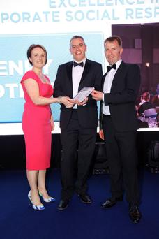 Henry Brothers won the Excellence in Corporate Social Responsibility award last year. Jennifer Cruickshank and Ian Henry received the award from Joe McDonald (centre) of sponsor ASDA