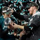 Prize guy: Nick Foles (left) gets the Vince Lombardi trophy from Carson Wentz