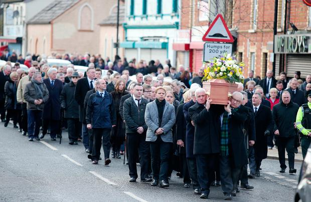 Friends and family attend the funeral of Robert Flowerday
