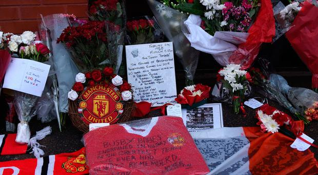Flowers and momentos are left outside Old Trafford stadium during a ceremony to commemorate the victims of a plane crash 60 years ago, in Munich, Germany when eight players and three team members of English football club Manchester United were killed, on February 6, 2018 in Manchester, north west England.