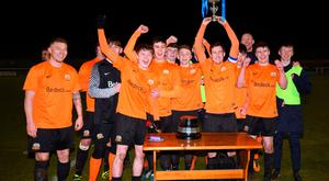 Just champion: Glenavon players celebrate their Mid-Ulster Cup final victory last night