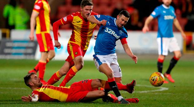 Ground work: Rangers' Jason Holt is tackled by Partick Thistle's Martin Woods (floor)