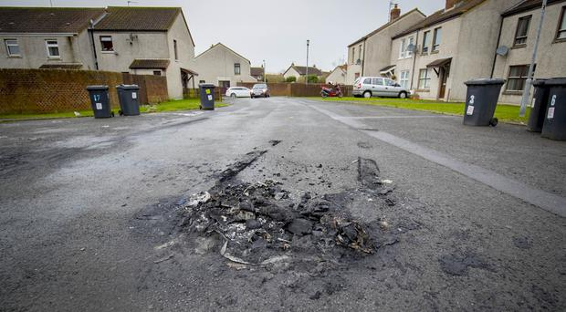 The scene in the Fairfield Place area of Newtownards where delivery driver has been attacked by two men who set fire to his car on February 7 2018 (Photo by Kevin Scott / Belfast Telegraph)