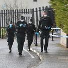 Police and Forensic Officers at the scene after a small explosion in west Belfast. Picture Pacemaker.