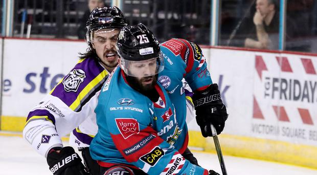 Ice cool: Belfast Giants' Blair Riley is put under pressure by Manchester Storm's Dallas Ehhrhardt