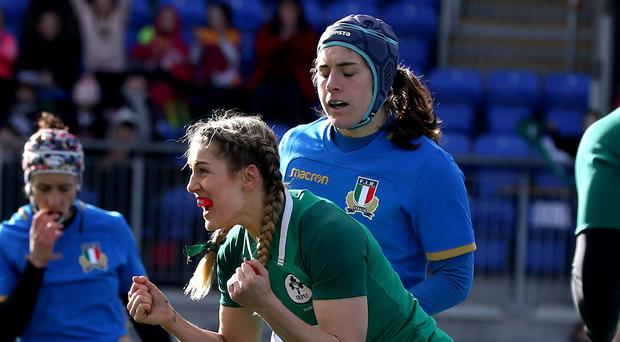 First win: Ireland's Megan Williams celebrates her try
