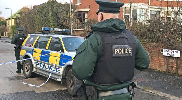 Police officers at the scene of the incident at Lismoyne Park in north Belfast