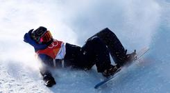 Aimee Fuller of Great Britain crashes in the Snowboard Ladies' Slopestyle Final