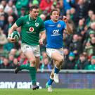 Ireland's Robbie Henshaw on his way to scoring his side's fifth try .