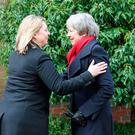 Northern Ireland Secretary Karen Bradley welcomes Prime Minister Theresa May to Stormont in Belfast where they will meet the main political parties as they continue talks aimed at ending the 13-month political stalemate. Niall Carson/PA Wire