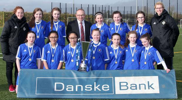 Holy Cross, Strabane, were presented with their trophy by Danske Bank Antrim Branch manager Richard Laplsey. Picture by Jonathan Porter/PressEye